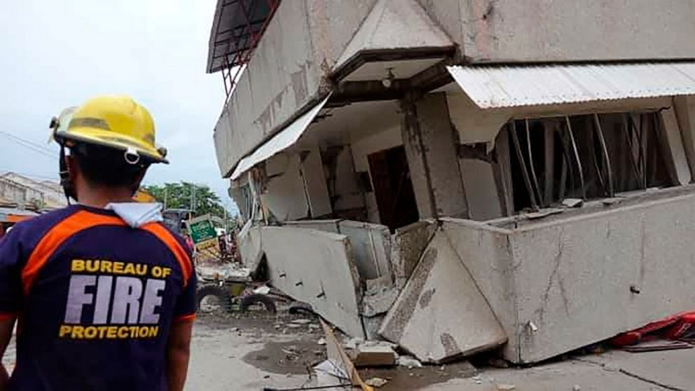 Rescuers search building rubble after Philippines earthquake