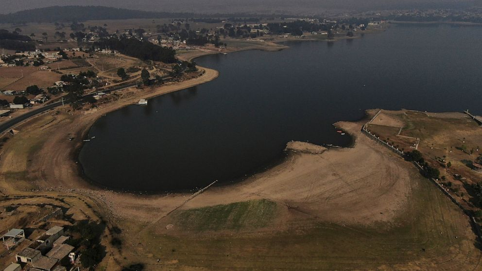 An aerial view of Villa Victoria Dam, the main water supply for Mexico City residents, on the outskirts of Toluca, Mexico Thursday, April 22, 2021. Drought conditions now cover 85% of Mexico, and in areas around Mexico City and Michoacán, the problem