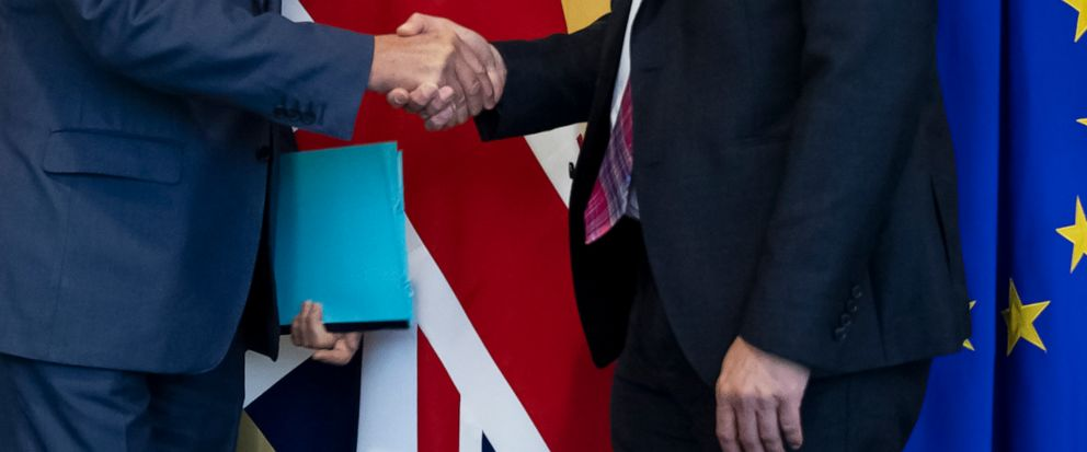 UK Brexit secretary Stephen Barclay, right, shakes hands with European Union chief Brexit negotiator Michel Barnier before their meeting at the European Commission headquarters in Brussels, Friday, Oct. 11, 2019. (AP Photo/Francisco Seco, Pool)