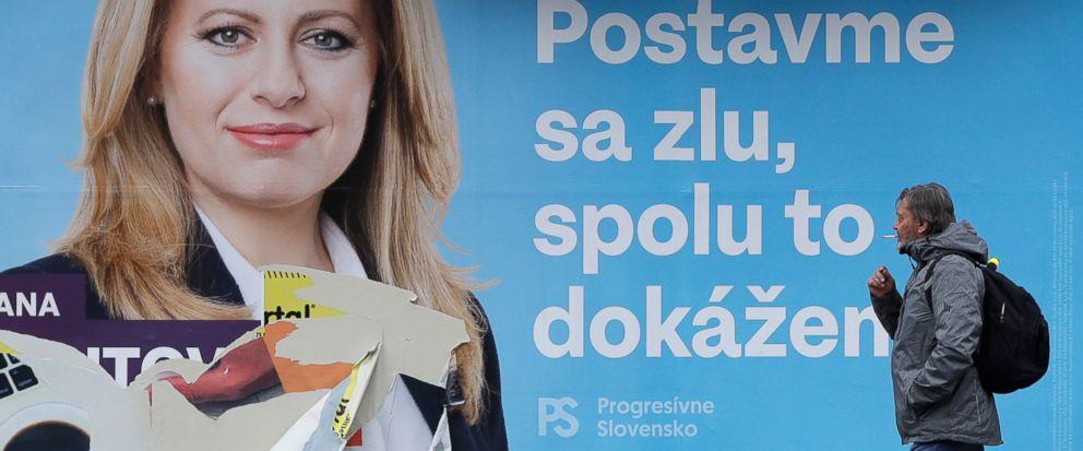 A man walks past a campaign poster for Zuzana Caputova in Bratislava 6f3d398d493