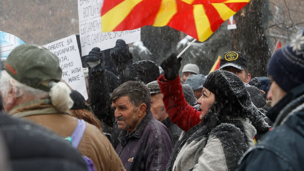 Opponents to the change of the country's constitutional name protest outside the parliament building prior to a session of the Macedonian Parliament in the capital Skopje, Wednesday, Jan. 9, 2019. Macedonian lawmakers are entering the last phase of debate on constitutional changes to rename their country North Macedonia as part of a deal with neighboring Greece to pave the way for NATO membership and eventually joining the European Union. (AP Photo/Boris Grdanoski)