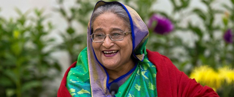 FILE - In this Monday, Dec. 31, 2018, file photo, Bangladeshi Prime Minister Sheikh Hasina interacts with journalists in Dhaka, Bangladesh. Hasina is set to begin a third straight term as Bangladeshs prime minister after a landslide election victory