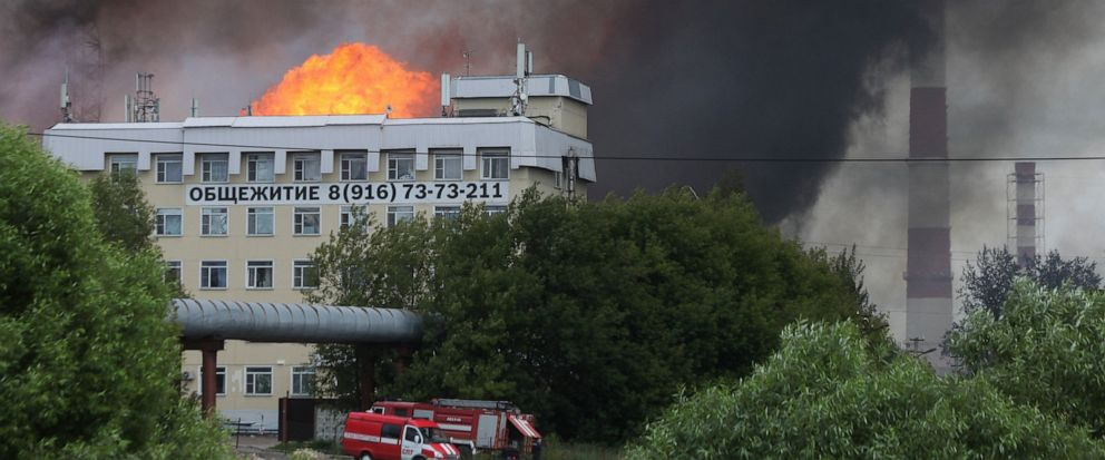 Black smoke and flames rise over a power station, in Mytishchi, outside Moscow, Russia, Thursday, July 11, 2019.The fire broke out on Thursday on the premises of a power station just outside Moscow, injuring five people. ( Sergey Vedyashkin, Moscow N