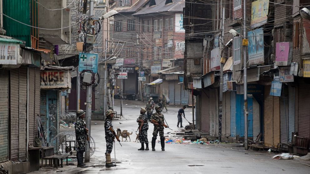 The Latest: Strict curfew eased in Kashmir, tensions high