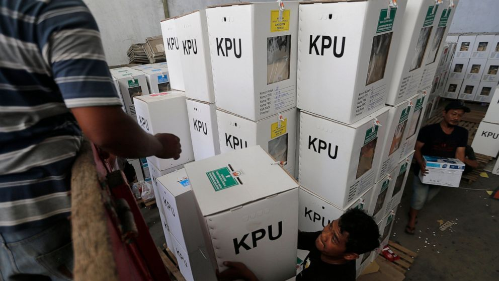 Electoral workers load ballot boxes into a truck to be distributed to polling stations on the outskirts of Jakarta, Indonesia, Monday, April 15, 2019. The world's third-largest democracy is gearing up to hold its legislative and presidential elections on April 17.(AP Photo/Tatan Syuflana)
