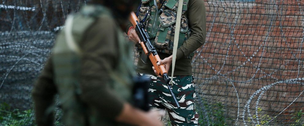 Indian paramilitary soldiers guard in Srinagar, Indian controlled Kashmir, Wednesday, June 12, 2019. Police say rebels fighting against Indian rule in disputed Kashmir have launched an attack on paramilitary soldiers, killing three. One militant also