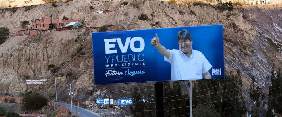 "A campaign poster featuring President Evo Morales giving a thumbs up reads in Spanish ""Evo and the people. Secure future"" on the outskirts of La Paz, Bolivia, Tuesday, Oct. 8, 2019. Morales coasted to victory in previous elections, becoming the longe"