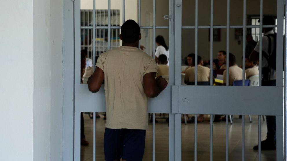 A young inmates looks at another group of fellow inmates during choir practice at the Las Garzas de Pacora detention center, Panama, Wednesday, Jan. 16, 2019. Pope Francis nearly always makes side visits to prisons during his foreign trips, in keeping with his belief that even those on the lowest rungs of society have dignity and need ministry. (AP Photo/Arnulfo Franco)
