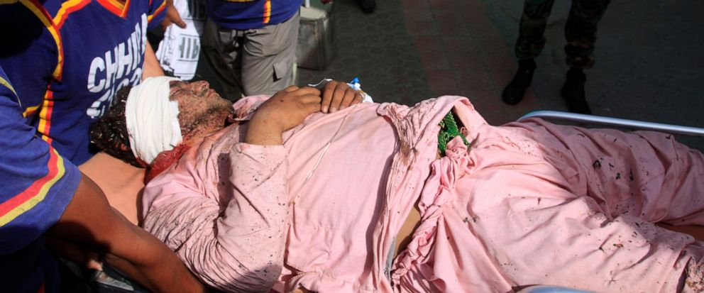 Pakistan I volunteers run an injured person to a hospital in Quetta, Pakistan, Friday, Aug. 16, 2019. Pakistani police say a powerful bomb went off inside a mosque during Friday prayers on the outskirts of the southwestern city of Quetta, killing man