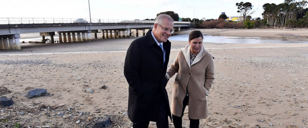 Australian Prime Minister Scott Morrison and his wife Jenny walk along the Cam River at Somerset, Australia Tuesday, May 14, 2019. A federal election will be held in Australian on Saturday, May 18, 2019. (Mick Tsikas/AAP Image via AP)