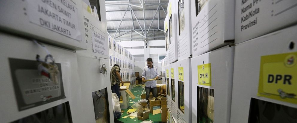Workers prepare ballot boxes to be distributed to polling stations in Jakarta, Indonesia, Monday, April 15, 2019. The worlds third-largest democracy is gearing up to hold its legislative and presidential elections on April 17.(Achmad Ibrahim)