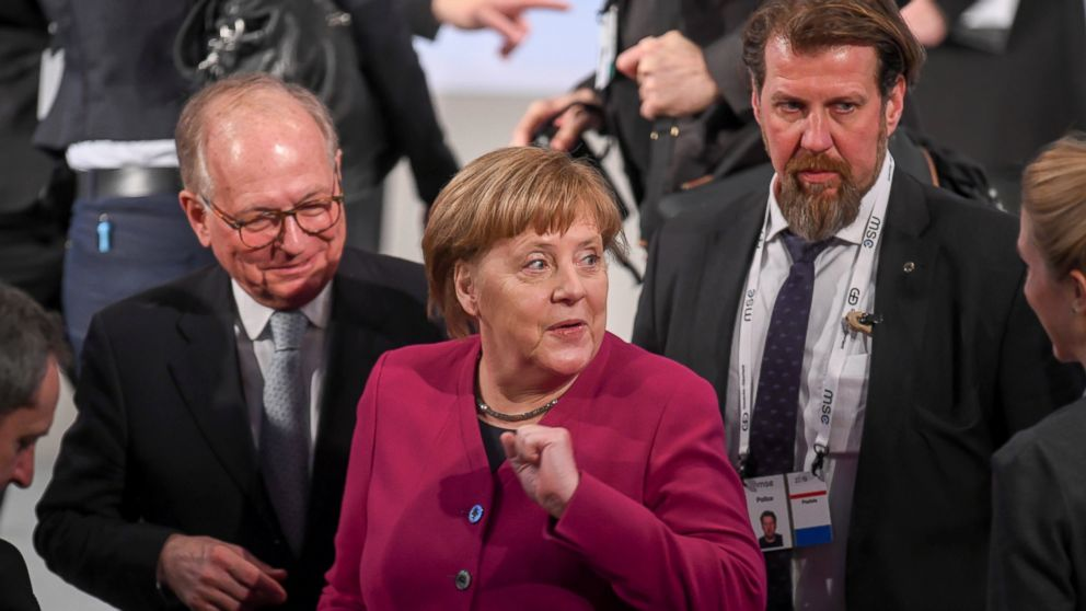 German Chancellor Angele Merkel, center, arrives for a meeting during the Munich Security Conference in Munich, Germany, Saturday, Feb. 16, 2019. (Tobias Hase/dpa via AP)