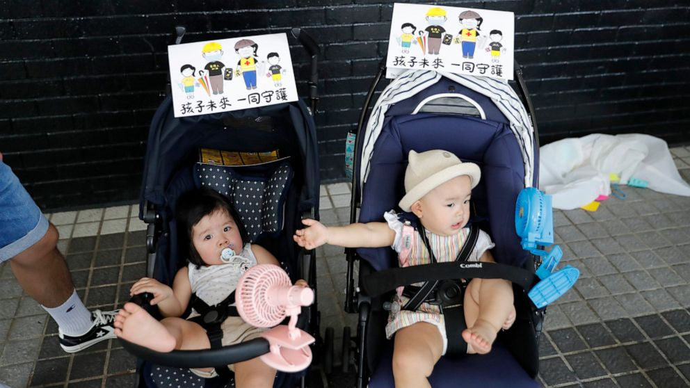 Hong Kong residents demand release of arrested woman