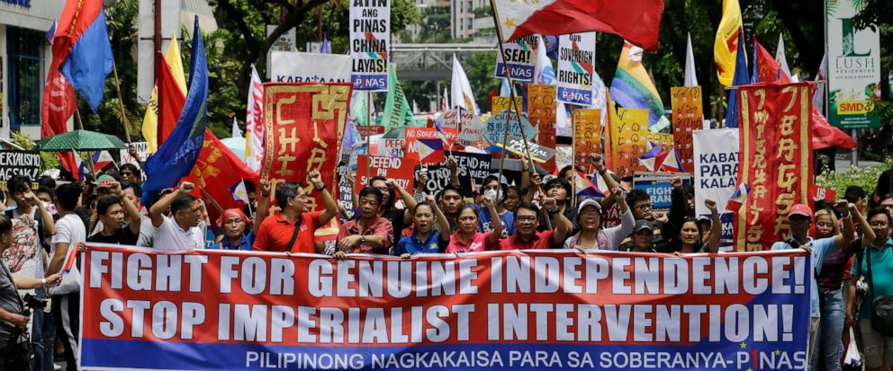 Protesters march towards the Chinese Consulate at the financial district of Makati, metropolitan Manila to mark Philippine Independence Day on Wednesday, June 12, 2019. The group said they condemn the administration of Philippine President Rodrigo Du