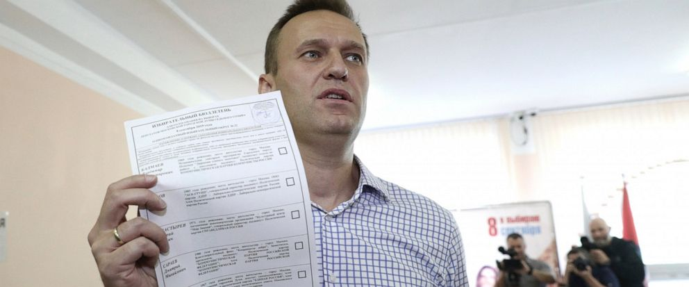 Russian opposition leader Alexei Navalny shows his ballot as he arrives to vote during a city council election in Moscow, Russia, Sunday, Sept. 8, 2019. Residents of Russias capital are voting in a city council election that is shadowed by a wave of
