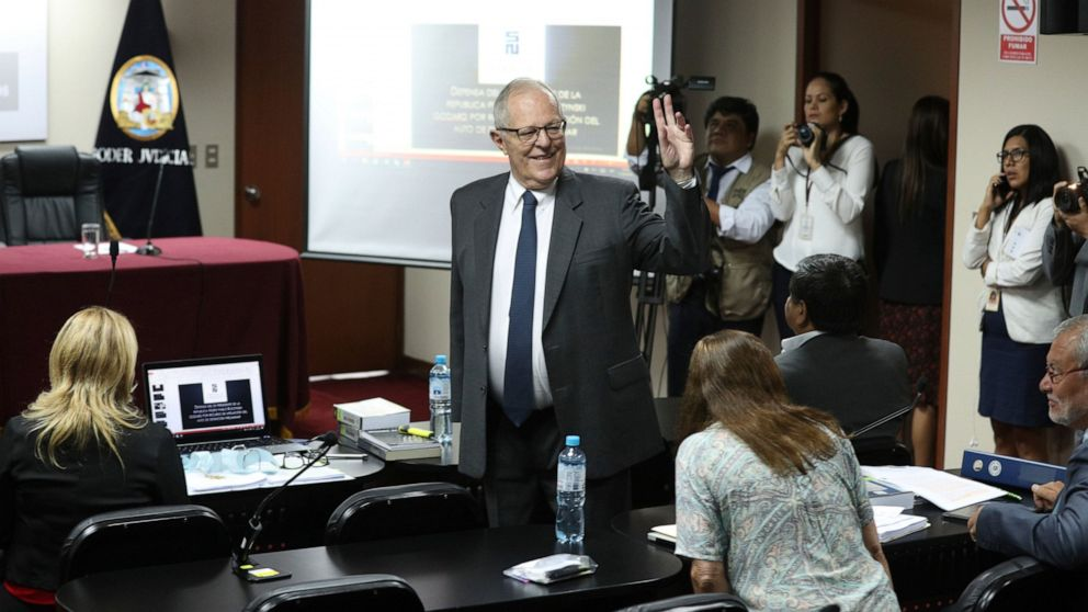 Peru's former President Pedro Pablo Kuczynski arrives for a court hearing to determine his release, in Lima, Peru, Monday, April 15, 2019. A judge in Peru ordered last week the detention for 10 days of the former leader as part of a money laundering probe into his consulting work for the company at the heart of Latin America's biggest graft scandal. (AP Photo/Martin Mejia)