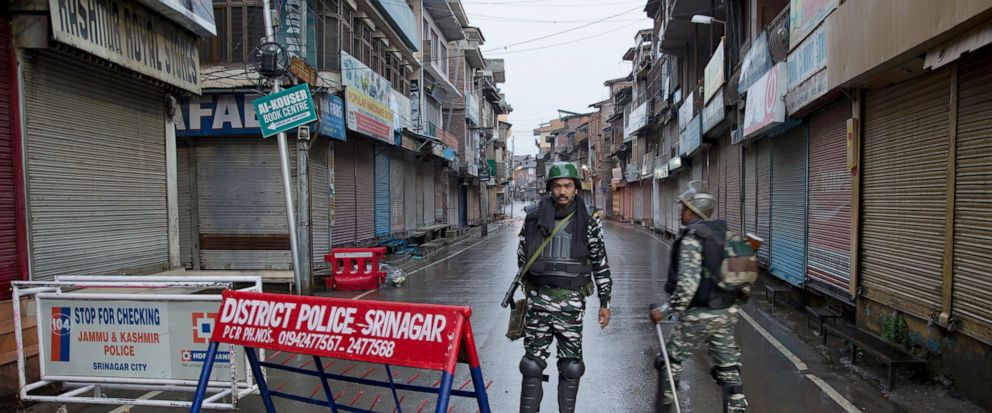 Indian paramilitary soldiers stand guard during security lockdown in Srinagar, Indian controlled Kashmir, Wednesday, Aug. 14, 2019. India has maintained an unprecedented security lockdown to try to stave off a violent reaction to Kashmirs downgraded