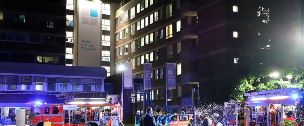Firefighters stay in front of the Marien Hospital (St. Marys Hospital) in Duesseldorf, Germany, Tuesday, Sept. 10, 2019. Officials say one person has died and 19 more have been injured in a fire at a hospital in the western German city of Duesseld