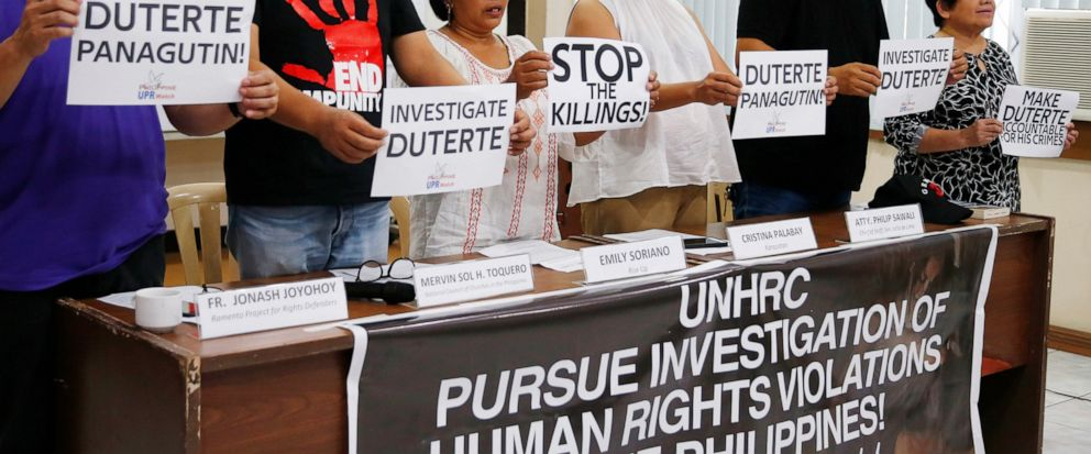 Human rights advocates display placards during a news conference following United Nations Human Rights Councils resolution in Geneva, Friday, July 12, 2019 in suburban Quezon city, northeast of Manila, Philippines. The U.N.s top human rights body h