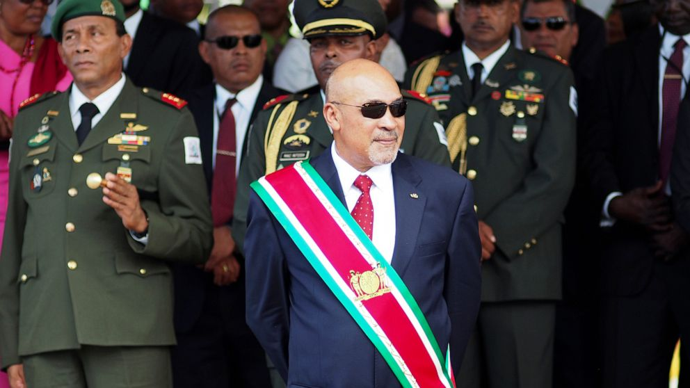 Supporters greet Suriname president after conviction thumbnail