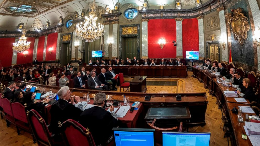 Twelve separatist leaders sit, center, during the trial at the Spanish Supreme Court in Madrid, Tuesday, Feb. 12, 2019. Spain is bracing for the nation's most sensitive trial in four decades of democracy this week, with a dozen Catalan separatists facing charges including rebellion over a failed secession bid in 2017. (AP Photo/Emilio Naranjo, Pool)