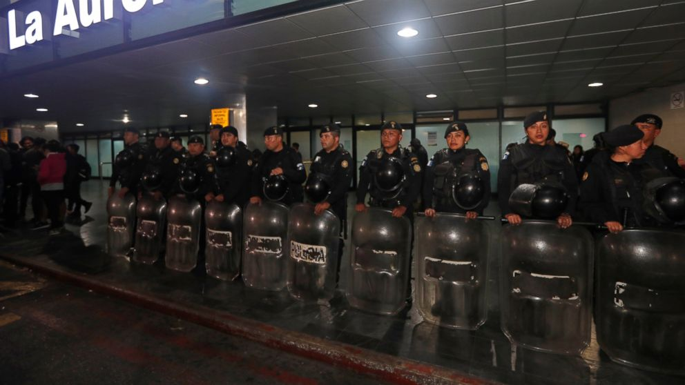 Anti-riot police stand guard at the La Aurora International Airport in Guatemala City, Sunday, Jan. 6, 2019. The Guatemalan government banned the entry of Yilen Osorio, an official of the International Commission Against Impunity in Guatemala (CICIG) and keeps it in the facilities of the La Aurora International Airport, despite the fact that the Constitutional Court ordered that they be granted visas and access to the members of the organism. (AP Photo/Moises Castillo)