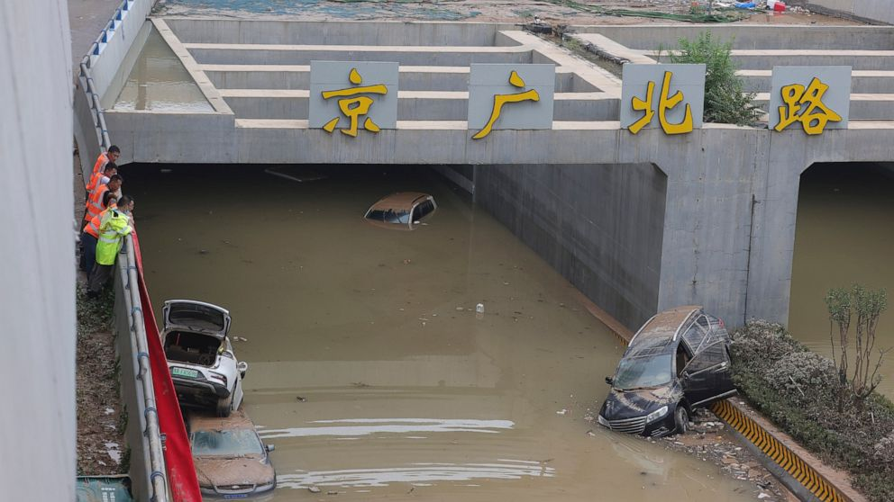 China moves residents out of flooded areas, drains tunnels