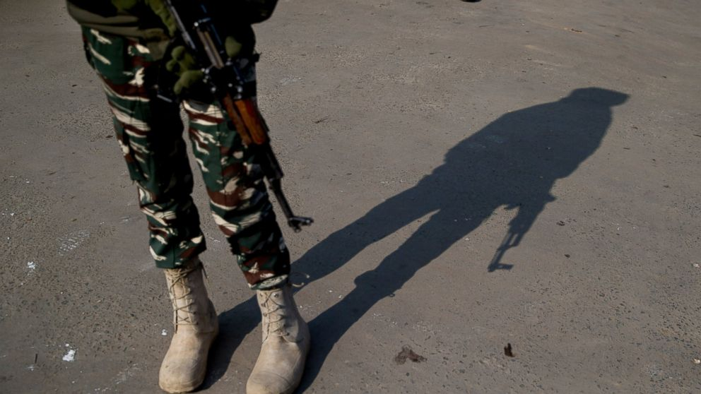 FILE- In this Feb. 3, 2019 file photo, a shadow of an Indian paramilitary soldier is cast as he stands guard at a temporary checkpoint during a strike in Srinagar, Indian controlled Kashmir. Five rebels were killed in fighting with government forces in disputed Kashmir on Sunday, the Indian army said, triggering anti-India clashes in which at least 10 civilians were injured. (AP Photo/Dar Yasin, File)