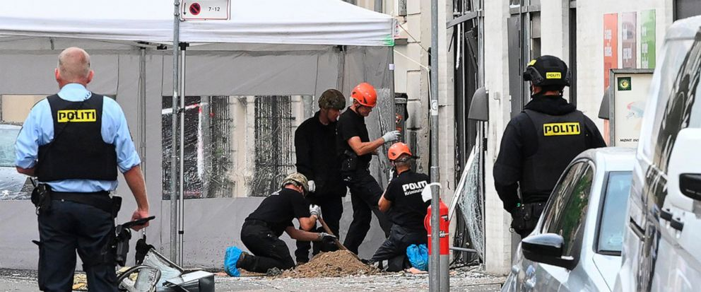 Danish police technicians inspect the scene outside of a local police station in Copenhagen, Saturday, Aug. 10, 2019, after it was hit by an explosion early morning, causing damage but no injuries. This follows-on from Tuesdays explosion which occur