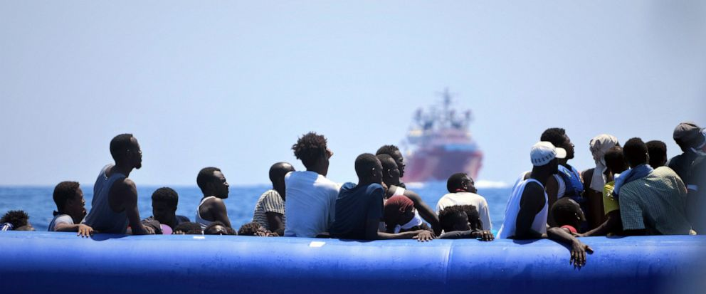 In this photo taken on Monday, Aug. 12, 2019, migrants on a dinghy boat wait to be assisted by the Ocean Viking ship, operated by the NGOs Sos Mediterranee and Doctors Without Borders, in the Mediterranean Sea. More than 500 rescued migrants are stuc
