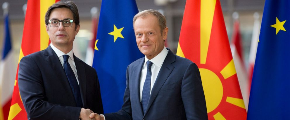 European Council President Donald Tusk, right, shakes hands with North Macedonias President Stevo Pendarovski prior to a meeting at the Europa building in Brussels, Wednesday, June 12, 2019. (AP Photo/Virginia Mayo)