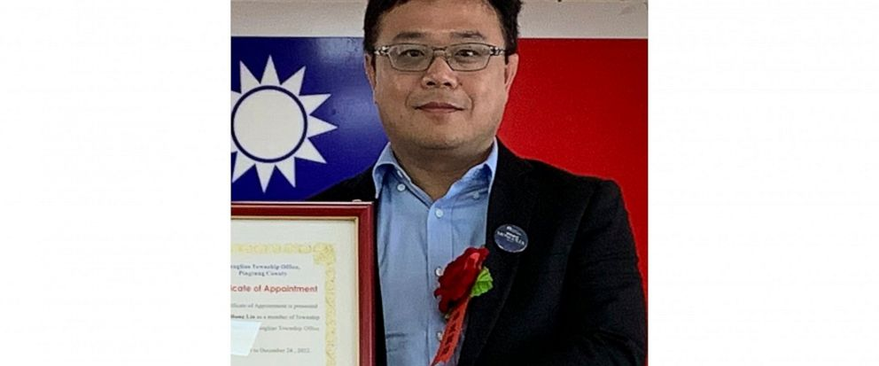 FILE - In this June 20, 2019, file photo released by Pingtung County Fangliao Township Office, Lee Meng-chu accepts a certificate for his adviser role during a ceremony in Pingtung County, Southern Taiwan. China has confirmed it is holding the Taiwan