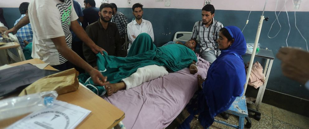 FILE - In this Saturday, Sept. 7, 2019, file photo, injured Kashmiri Mohammad Ashraf Dar lies on a hospital bed in Srinagar, Indian controlled Kashmir. Indian-controlled Kashmirs police chief Dilbagh Singh says a militant was killed during a brief s