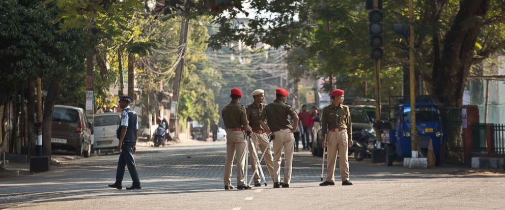Indian police officials stand leisurely on a deserted road during an eleven hour general strike called by All Assam Students Union (AASU) and North East Students Organization (NESO) in Gauhati, India, Tuesday, Jan. 8, 2019. India's populous northea