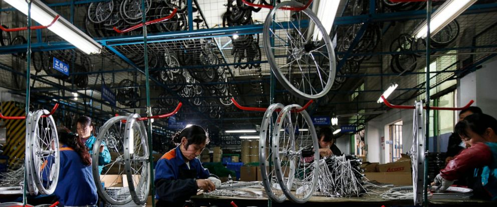 FILE - In this March 4, 2011, file photo, workers from the Dahon, the worlds largest maker of folding bicycles, assembles the bicycle wheels in Shenzhen, a city of southern China. The latest round of China tariff hikes, which went into effect Friday
