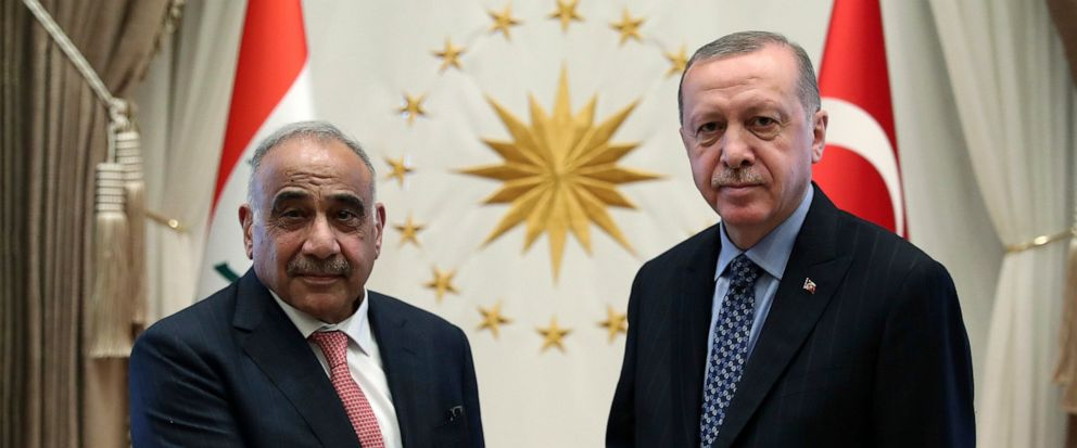 Turkish President Recep Tayyip Erdogan, right, and Iraqi Prime Minister Adel Abdul-Mahdi shake hands before a meeting, in Ankara, Turkey, Wednesday, May 15, 2019.(Presidential Press Service via AP, Pool)