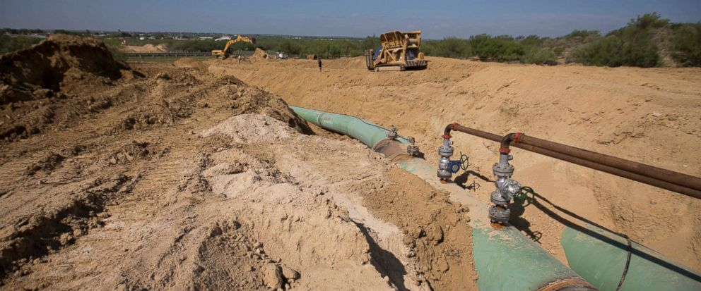 FILE - In this Sept. 7, 2014 photo, new pipelines to carry gas from Texas to Mexico, eventually reaching the city of Guanajuato, are laid underground near General Bravo, Nuevo Leon state, Mexico. Mexico's President Andres Manuel Lopez Obrador said Mo
