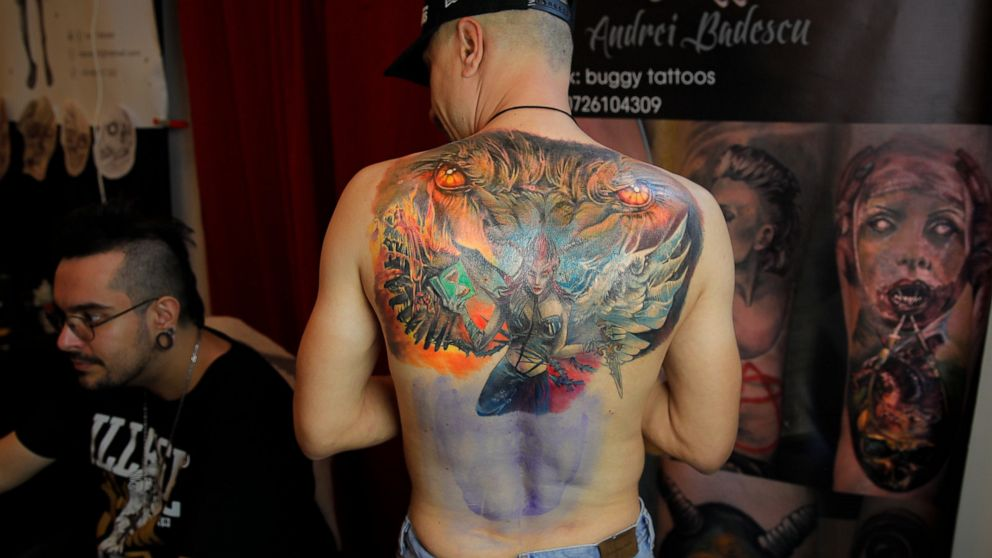 AP PHOTOS: Cream of tattoos on show at Romanian palace thumbnail