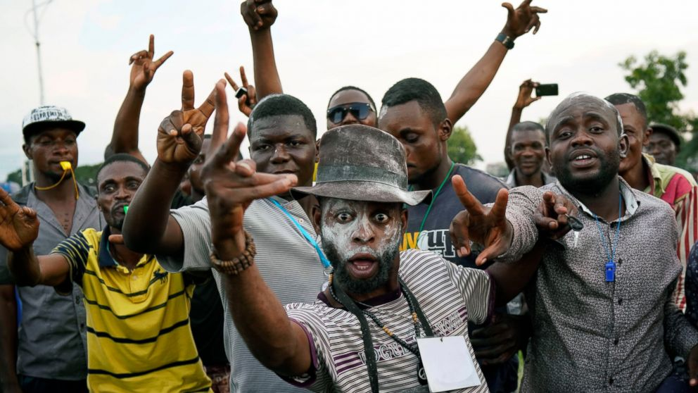Supporters of opposition presidential candidate Felix Tshisekedi party outside his headquarters as they wait for election results to be released in Kinshasa, Congo, Wednesday Jan. 9, 2019. As Congo anxiously awaits the outcome of the presidential election, many in the capital say they are convinced that the opposition won and that the delay in announcing results is allowing manipulation in favor of the ruling party. (AP Photo/Jerome Delay)
