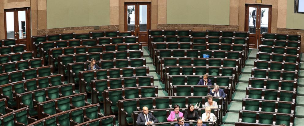 A lawmaker from Polands ruling party addresses an almost empty lower house during the last session of parliament before Oct.13 general election,in Warsaw, Poland, Wednesday, Sept. 11, 2019. In an unprecedented move, the ruling party is having the se