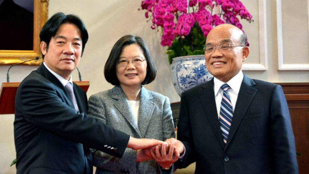 Taiwanese President Tsai Ing-wen, center, holds hands with Su Tseng-chang, right, and William Lai in Taipei, Taiwan, Friday, Jan. 11, 2019. Tsai appointed a close political ally. Su, Friday as premier during a Cabinet reshuffle following the ruling Democratic Progressive Party's heavy losses in local elections. Su took charge of the Cabinet amid tense relations with China, which threatens to use force to take control of the island it claims as its own. (Eiichi Shiozawa/Kyodo News via AP)