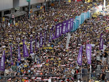 Hong Kong protesters continue past march's end point