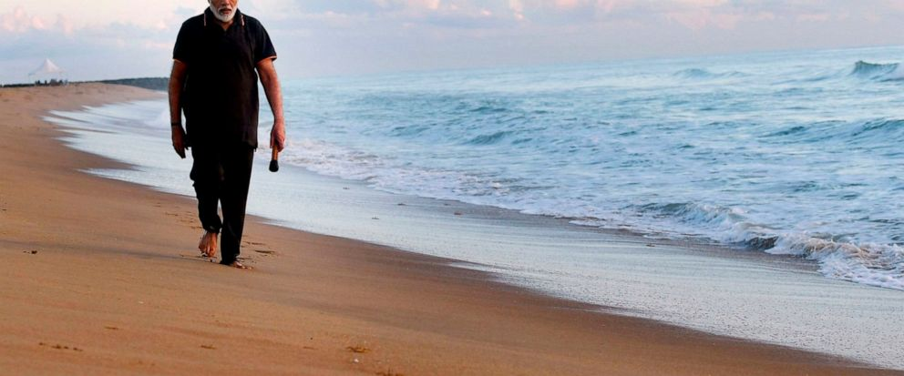 In this photo provided by Prime Minister of India Narendra Modis twitter handle, Indian Prime Minister Narendra Modi takes morning walk at a beach in Mamallapuram, in southern India, Saturday, Oct. 12, 2019. Indias foreign ministry said Chinese Pre