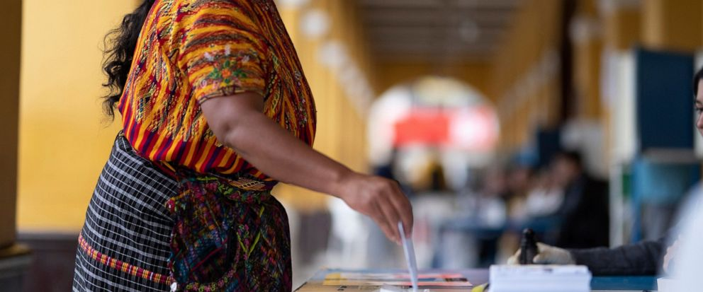 A woman casts her vote at a polling station, in San Juan Sacatepequez, Sunday, Aug. 11, 2019. The second-round presidential runoff has ex-first lady Sandra Torres running against conservative Alejandro Giammattei in a nation beset by poverty, unemplo