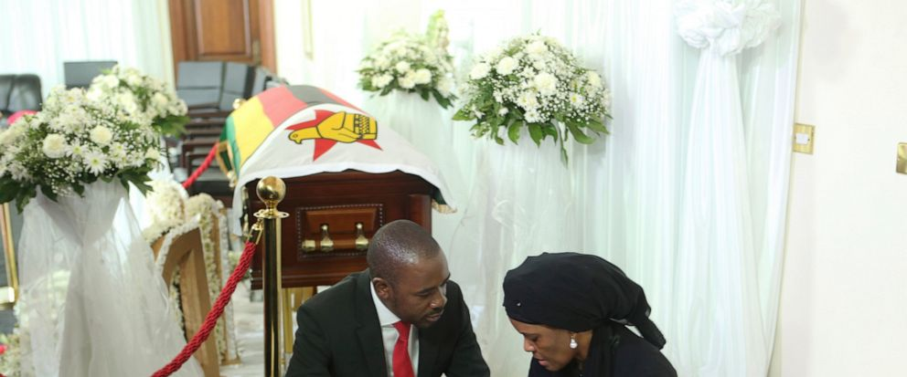 Nelson Chamisa, left, leader of the main opposition party in Zimbabwe, consoles Grace, wife to former Zimbabwean leader Robert Mugabe at his residence in Harare, Thursday Sept. 12, 2019. Zimbabwes founding leader Robert Mugabe made his final journey