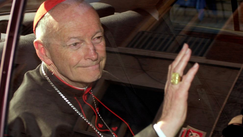 FILE - In this April 23, 2002 file photo Cardinal Theodore McCarrick of the Archdiocese of Washington, waves as he arrives at the Vatican in a limousine. On Saturday, Feb. 16, 2019 the Vatican announced Pope Francis defrocked former U.S. Cardinal Theodore McCarrick after Vatican officials found him guilty of soliciting for sex while hearing Confession. (AP Photo/Andrew Medichini, file)