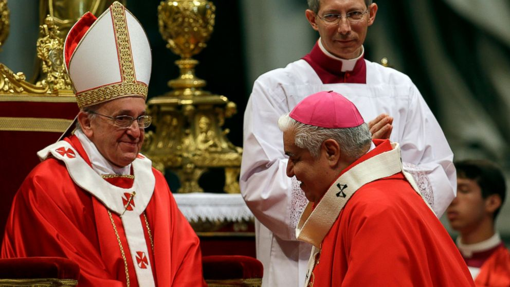 """FILE - In this June 29, 2013 file photo, Rogelio Cabrera, Archbishop of Monterrey, Mexico, is greeted by Pope Francis after receiving the Pallium, a woolen shawl symbolizing his bond to the pope, during a Mass in St. Peter's Basilica, at the Vatican. Cabrera, head of the Mexican Bishops' Council, said on Sunday, Feb. 10, 2019, that 152 Roman Catholic priests have been removed from the ministry over the last nine years for sex abuse offenses against """"youths or vulnerable adults."""" (AP Photo/Gregorio Borgia, File)"""