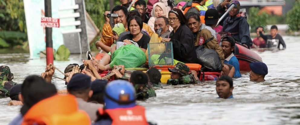 Residents ride a makeshift raft as they evacuate their flooded homes in Makassar, South Sulawesi, Indonesia, Wednesday, Jan. 23, 2019.(AP Photo/Masyudi Syachban Firmansyah)