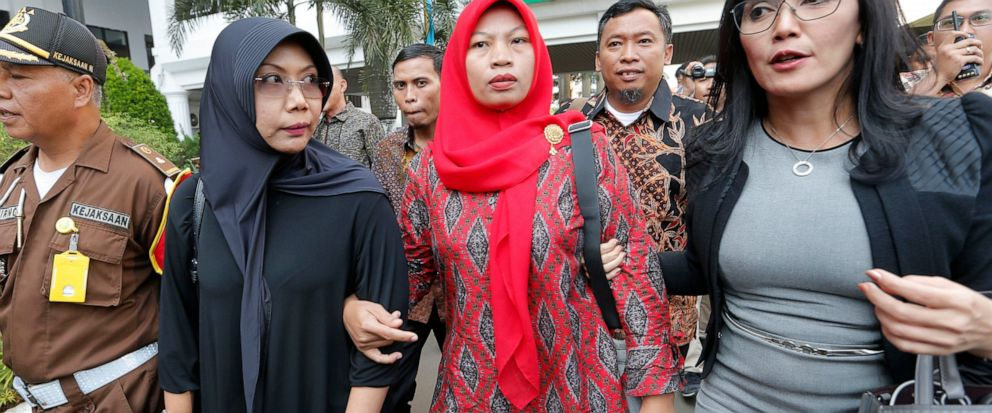 Baiq Nuril Maknun, center, arrives at the Attorney Generals office in Jakarta, Indonesia. Friday, July 12, 2019. Maknun facing six month in prison in Indonesia for recording her bosss sexual harassment is expected to receive a presidential amnesty