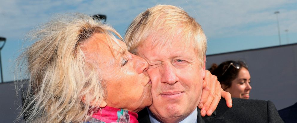Britains Conservative Party leadership candidate Boris Johnson, right, is greeted by a supporter during a campaign stop at the port of Dover, southeast England, Thursday July 11, 2019. The two contenders, Jeremy Hunt and Boris Johnson are competing